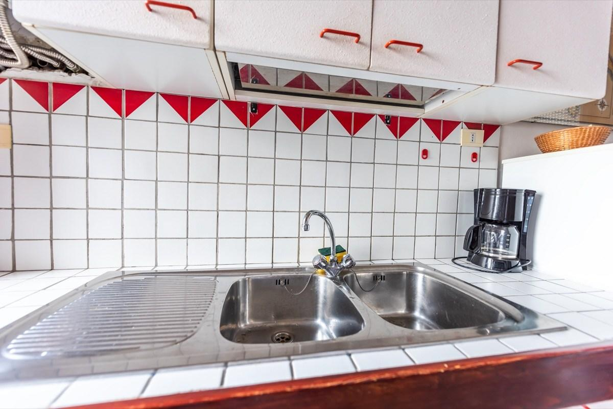 """If you want help making your home look out of place in today's world, your tile countertops are more than happy to oblige.  """"Everyone dislikes them, but it was a craze in the '80s,"""" says <strong>Karen Gray-Plaisted</strong>, founder of full-service decorating and home staging company <a href=""""http://designsolutionskgp.com/about/"""" target=""""_blank"""">Design Solutions KGP</a>. If you want to <a href=""""https://bestlifeonline.com/home-upgrades/?utm_source=yahoo-news&utm_medium=feed&utm_campaign=yahoo-feed"""" target=""""_blank"""">bring your home in to the modern era</a>, she recommends opting for quartz, natural stone, or concrete counters instead."""