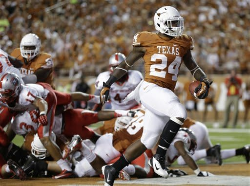 Texas' Joe Bergeron (24) scores a touchdown against New Mexico during the third quarter of an NCAA college football game on Saturday, Sept. 8, 2012, in Austin, Texas. (AP Photo/Eric Gay)