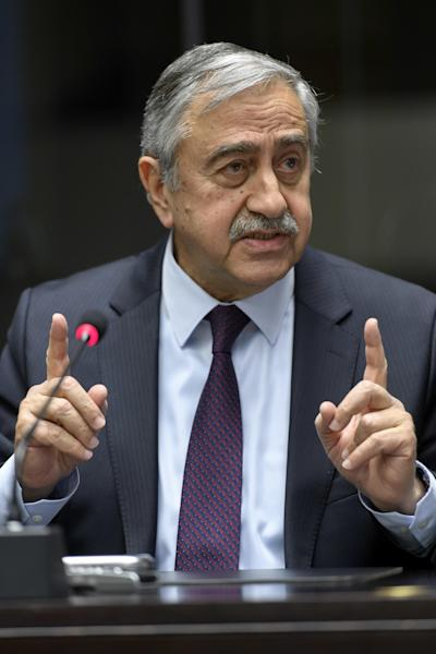 Turkish Cypriot leader Mustafa Akinci speaks to the media about the Cyprus Peace Talks, during a press conference at the European headquarters of the United Nations in Geneva, Switzerland, on Friday, Jan. 13, 2017. (Martial Trezzini/Keystone via AP)