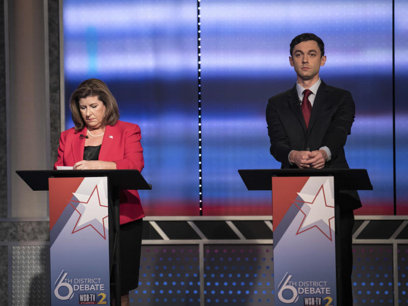 FILE - In this June 6, 2017 file photo, candidates in Georgia's 6th Congressional District race Republican Karen Handel, left, and Democrat Jon Ossoff prepare to debate in Atlanta. Handel and Ossoff are making their last push this weekend before voters in Georgia's 6th Congressional District cast ballots Tuesday, June 20, to replace Tom Price in Washington, a contest seen as an early political test for the Trump administration. (Branden Camp/Atlanta Journal-Constitution via AP)