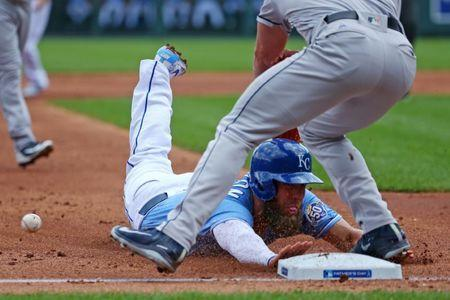 Jun 17, 2018; Kansas City, MO, USA; Kansas City Royals left fielder Alex Gordon (4) slides into third base ahead of the tag by Houston Astros third baseman Alex Bregman (2) in the first inning at Kauffman Stadium. Mandatory Credit: Jay Biggerstaff-USA TODAY Sports