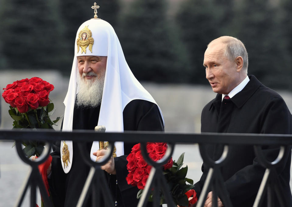 FILE - In this file photo from Nov. 4, 2018, Russian President Vladimir Putin and Russian Orthodox Church Patriarch Kirill, left, walk to lay flowers at the monument of Minin and Pozharsky at Red Square in Moscow, during National Unity Day. The Russian Church said on Friday, Dec. 14, 2018, that Patriarch Kirill has sent a letter to the U.N. secretary-general, German Chancellor Angela Merkel, French President Emmanuel Macron, Pope Francis, the Archbishop of Canterbury and other spiritual leaders, urging them to help protect the clerics, believers and their faith in Ukraine. (Alexander Nemenov/Pool Photo via AP, File)
