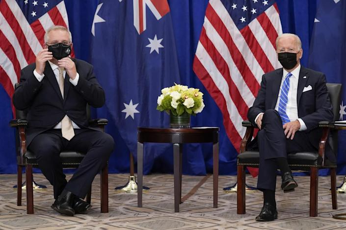 Australian Prime Minister Scott Morrison adjusted his mask during a meeting with President Biden.