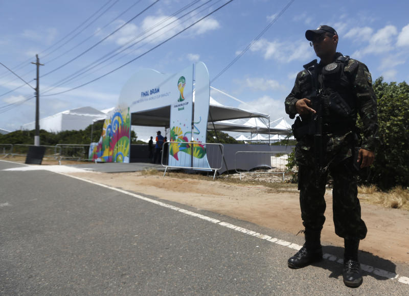 A soldier secures the entrance of the draw hall one day before the draw for the 2014 soccer World Cup in Costa do Sauipe near Salvador, Brazil, Thursday, Dec. 5, 2013. (AP Photo/Victor Caivano)