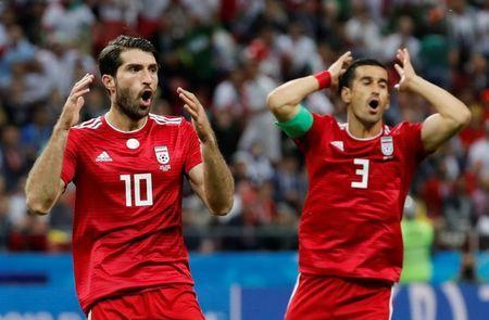 Soccer Football - World Cup - Group B - Iran vs Spain - Kazan Arena, Kazan, Russia - June 20, 2018 Iran's Ehsan Hajsafi and Karim Ansarifard react REUTERS/Toru Hanai