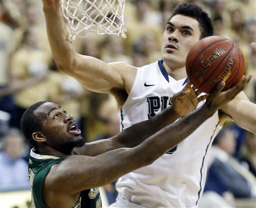South Florida's Toarlyn Fitzpatrick, left, shoots in front of Pittsburgh's Steven Adams during the second half of an NCAA college basketball game Wednesday, Feb. 27, 2013 in Pittsburgh. (AP Photo/Keith Srakocic)