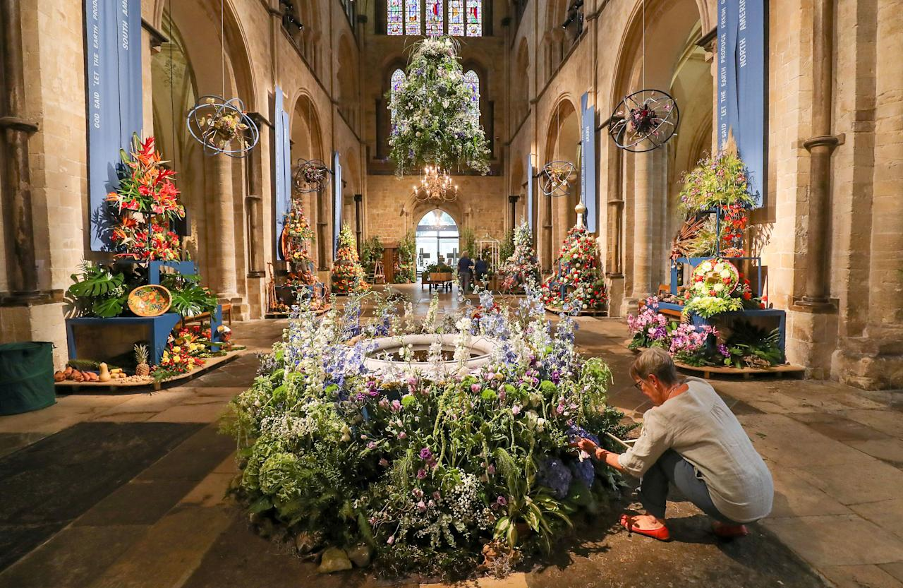 <p>Final preparations are made to displays inside Chichester Cathedral, as it is filled with 80 flower arrangements using over 50,000 flowers, to celebrate its annual Festival of Flowers, which this year has a theme of 'This Earthly Paradise'. (PA) </p>