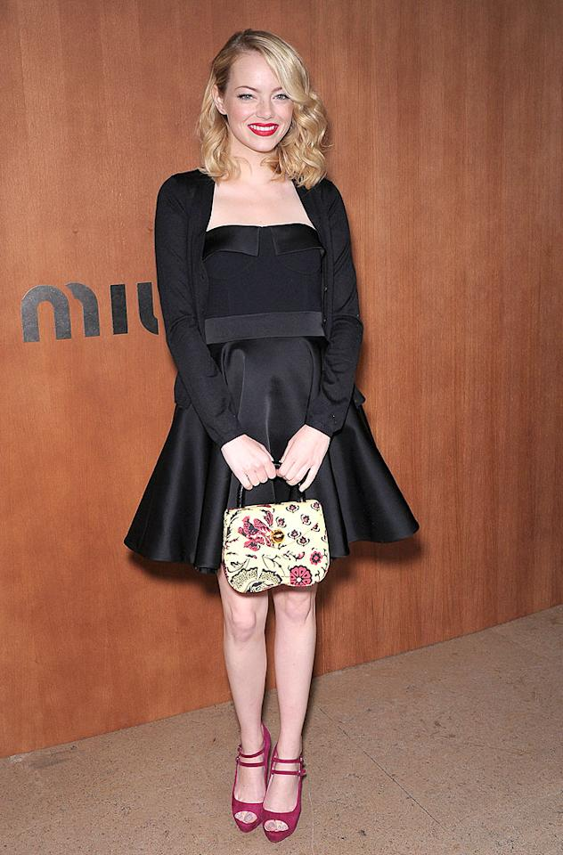 "Following in Seyfried's footsteps was the equally adorable Emma Stone, who was all smiles in her black satin cocktail frock and Miu Miu peep-toes. Andrew Garfield is undoubtedly one lucky man! (10/3/2012)<br><br><a target=""_blank"" href=""http://bit.ly/lifeontheMlist"">Follow 2 Hot 2 Handle creator, Matt Whitfield, on Twitter!</a>"