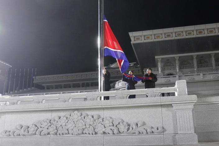 Exemplary workers during the national flag-hoisting ceremony during celebrations for the New Year, at Kim Il Sung Square in Pyongyang, North Korea, early Friday, Jan., 1, 2021. (AP Photo/Jon Chol Jin)