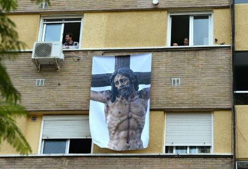 With a nationwide lockdown in place to curb the spread of COVID-19, Spaniards are finding ways to mark Holy Week from their homes