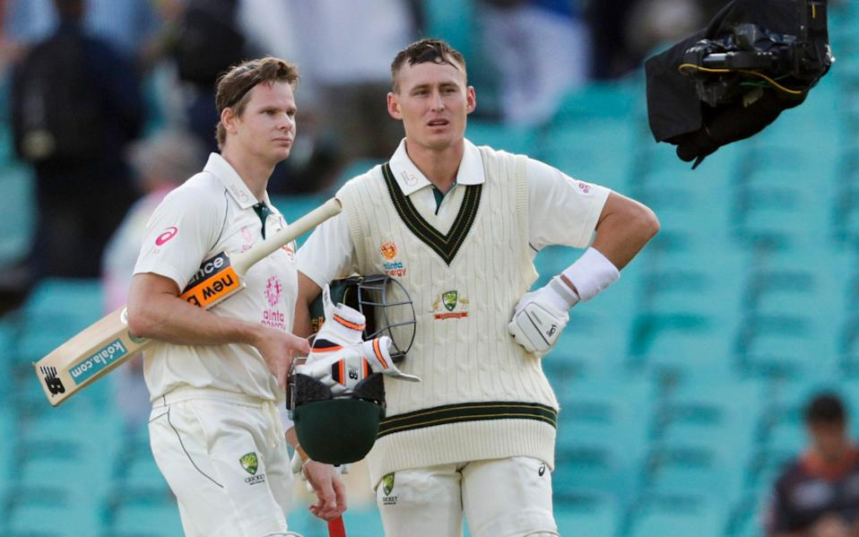 Australia's Steve Smith, left, and Marnus Labuschagne are interviewed on camera following play on day one of the third cricket test between India and Australia at the Sydney Cricket Ground, Sydney, Australia, Thursday, Jan. 7, 2021. - AP