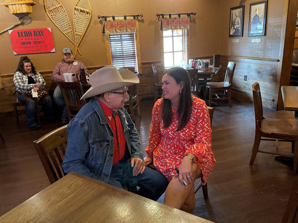 Former White House Press Secretary Sarah Sanders talks to Harold Glenn Earnest while campaigning at a Colton's Steak House in Cabot, Ark., Friday, Sept. 10, 2021. Sanders is running for the Republican nomination for governor in Arkansas. (AP Photo/Andrew DeMillo)