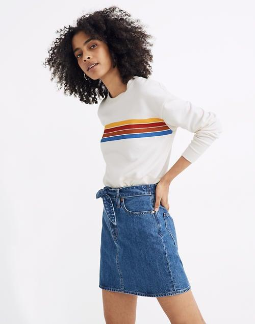 "<p>The belt on this <a href=""https://www.popsugar.com/buy/Madewell-Rigid-Denim-Straight-Mini-Skirt-582009?p_name=Madewell%20Rigid%20Denim%20Straight%20Mini%20Skirt&retailer=madewell.com&pid=582009&price=70&evar1=fab%3Aus&evar9=35329485&evar98=https%3A%2F%2Fwww.popsugar.com%2Ffashion%2Fphoto-gallery%2F35329485%2Fimage%2F47550215%2FMadewell-Rigid-Denim-Straight-Mini-Skirt&list1=shopping%2Cdenim%2Csummer%20fashion%2Cfashion%20shopping&prop13=mobile&pdata=1"" class=""link rapid-noclick-resp"" rel=""nofollow noopener"" target=""_blank"" data-ylk=""slk:Madewell Rigid Denim Straight Mini Skirt"">Madewell Rigid Denim Straight Mini Skirt</a> ($70, originally $80) is so cute.</p>"