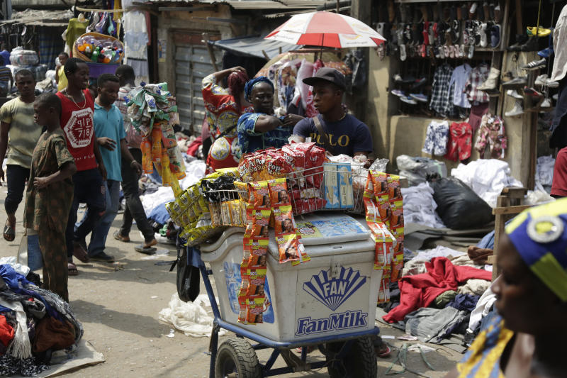"""Pedestrians shop in a roadside market in Lagos, Nigeria, Friday, Jan. 12, 2018. Africans were shocked on Friday to find President Donald Trump had finally taken an interest in their continent. But it wasn't what people had hoped for. Using vulgar language, Trump on Thursday questioned why the U.S. would accept more immigrants from Haiti and """"shithole countries"""" in Africa rather than places like Norway in rejecting a bipartisan immigration deal. On Friday he denied using that language. (AP Photo/Sunday Alamba)"""