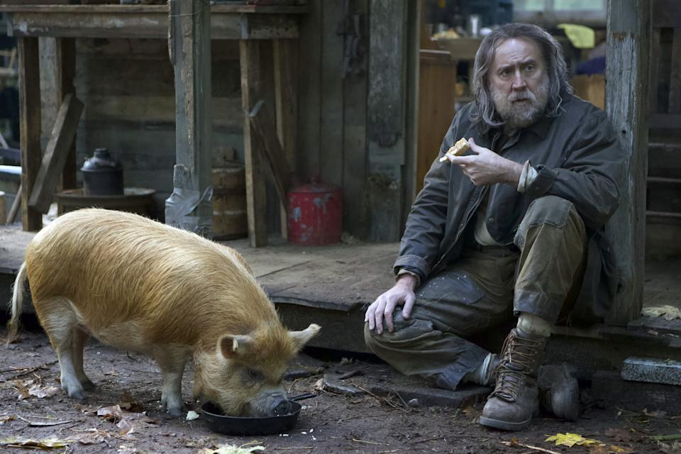 Nicolas Cage and his porcine co-star in the new drama,