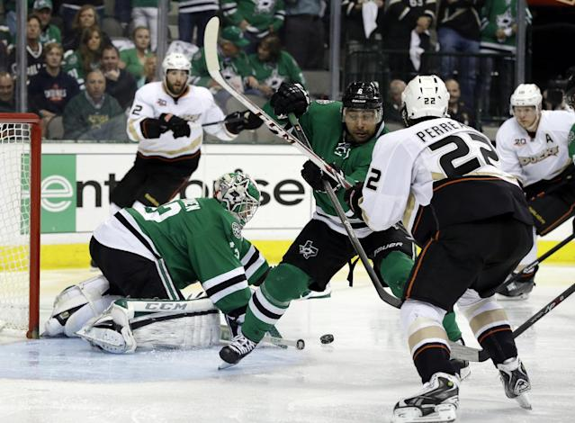 Dallas Stars' Kari Lehtonen (32), of Finland, defends on a shot as defenseman Trevor Daley (6) helps against pressure from Anaheim Ducks center Mathieu Perreault (22) in the second period of Game 4 of a first-round NHL hockey Stanley Cup playoff series, Wednesday, April 23, 2014, in Dallas. (AP Photo/Tony Gutierrez)