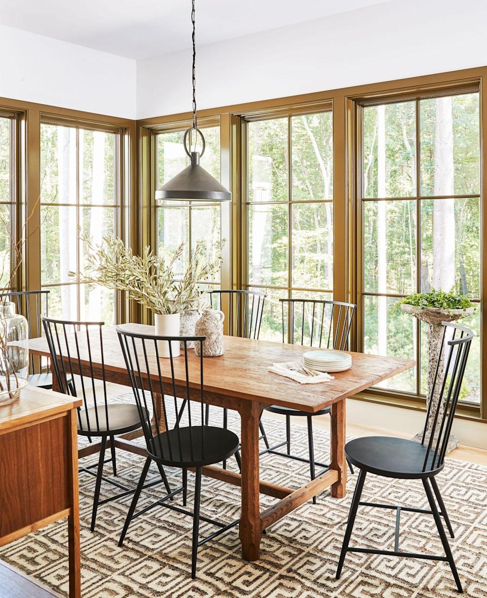 """<p>In our <a href=""""https://www.southernliving.com/home/idea-houses/2020-idea-house-tour"""" rel=""""nofollow noopener"""" target=""""_blank"""" data-ylk=""""slk:2020 Idea House"""" class=""""link rapid-noclick-resp"""">2020 Idea House</a>, interior designer Lauren Liess called on the local mountain landscape for palette inspiration. This<a href=""""https://www.sherwin-williams.com/homeowners/color/find-and-explore-colors/paint-colors-by-family/SW9530-momentum"""" rel=""""nofollow noopener"""" target=""""_blank"""" data-ylk=""""slk:earthy green"""" class=""""link rapid-noclick-resp""""> earthy green</a> was a natural fit.</p>"""