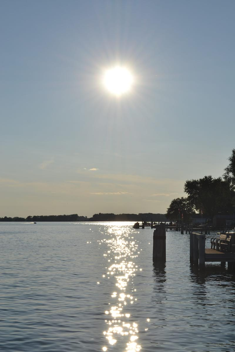 The sun reflects off the water of Lake Butte des Morts in Wisconsin in this 2012 photo.