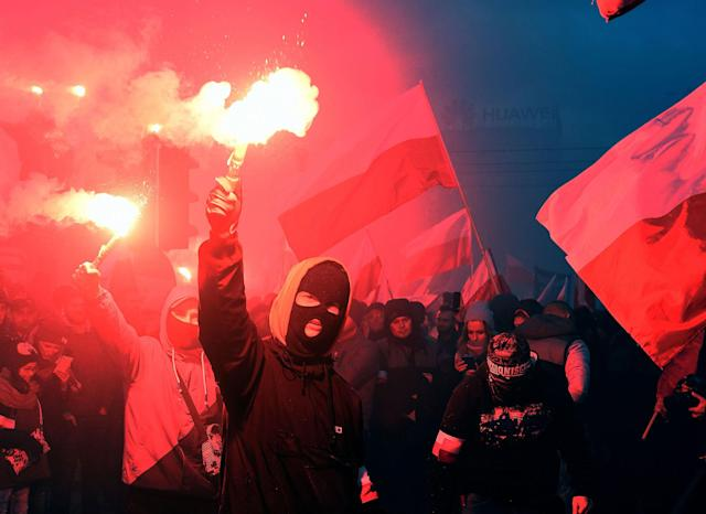 <p>Demonstrators burn flares and wave Polish flags during the annual march to commemorate Poland's National Independence Day in Warsaw on Nov. 11, 2017. (Photo: Janek Skarzynski/AFP/Getty Images) </p>