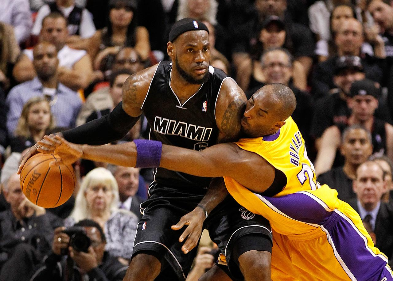 MIAMI, FL - JANUARY 19:  LeBron James #6 of the Miami Heat is guarded by Kobe Bryant #24 of the Los Angeles Lakers during a game at American Airlines Arena on January 19, 2012 in Miami, Florida. NOTE TO USER: User expressly acknowledges and agrees that, by downloading and/or using this Photograph, User is consenting to the terms and conditions of the Getty Images License Agreement.  (Photo by Mike Ehrmann/Getty Images)