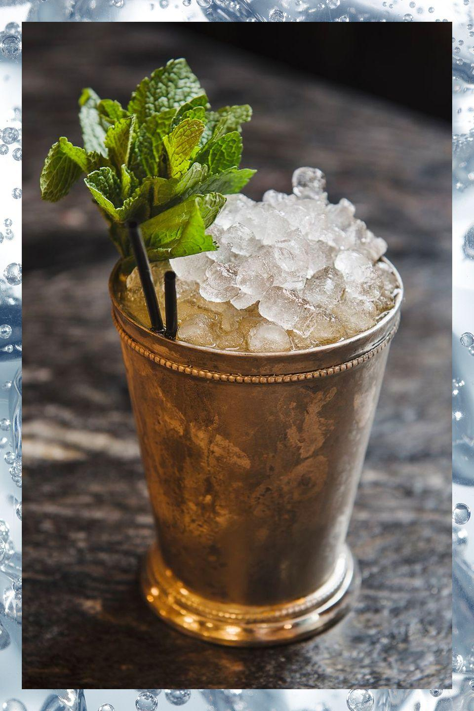 """<p>The <a href=""""https://www.townandcountrymag.com/leisure/drinks/how-to/g1261/kentucky-derby-party-southern-cocktails/"""" rel=""""nofollow noopener"""" target=""""_blank"""" data-ylk=""""slk:official drink of the Kentucky Derby"""" class=""""link rapid-noclick-resp"""">official drink of the Kentucky Derby</a> is worth ordering even when you're not at Churchill Downs.</p><p>- 2 oz bourbon<br>- 8-10 mint leaves<br>- .25 oz simple syrup</p><p><em>Muddle the mint leaves and simple syrup in a <a href=""""https://www.amazon.com/gp/product/B001L2XWFG/?tag=syn-yahoo-20&ascsubtag=%5Bartid%7C10067.g.13092298%5Bsrc%7Cyahoo-us"""" rel=""""nofollow noopener"""" target=""""_blank"""" data-ylk=""""slk:mint julep cup"""" class=""""link rapid-noclick-resp"""">mint julep cup</a>. Add bourbon and fill with with crushed ice. Stir until the cup is frosted. Fill with more crushed ice. Serve with a straw and a mint sprig garnish.</em></p><p><strong>More</strong>: <a href=""""https://www.townandcountrymag.com/leisure/drinks/how-to/g667/kentucky-derby-mint-julep-guide/"""" rel=""""nofollow noopener"""" target=""""_blank"""" data-ylk=""""slk:Mint Julep Cocktails We Love to Drink on Derby Day"""" class=""""link rapid-noclick-resp"""">Mint Julep Cocktails We Love to Drink on Derby Day</a></p>"""