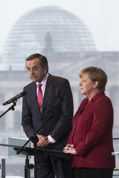 German Chancellor Angela Merkel, right, and the Prime Minister of Greece, Antonis Samaras, give a statement prior to a meeting at the chancellery in Berlin, Tuesday, Jan. 8, 2013. (AP Photo/Markus Schreiber)