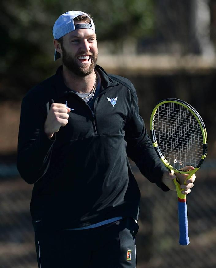 Professional tennis player Jack Sock pumps his fist after winning a point against his coach Alex Bogomolov Jr. at the Cabarrus Country Club in Concord, NC on Wednesday, January 20, 2021.