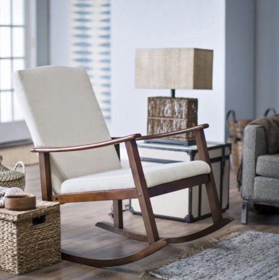 "This rocking chair has a durable solid birch wood frame and curved armrests for added comfort and support. Get it at <a href=""https://www.hayneedle.com/product/holdenmodernrockingchairupholsteredivory.cfm"" target=""_blank"">Hayneedle</a>."