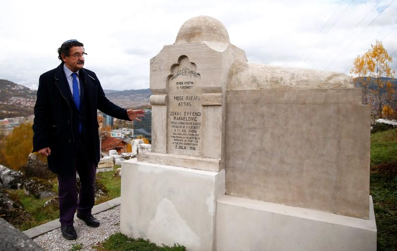 Eli Tauber stands near the resting place of a Jew, whose real name is Mose Atijas, known as Zeki Efendi Rafaelovic, at the Jewish cemetery in Sarajevo
