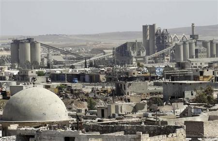 A general view shows a cement factory that activists said is controlled by forces loyal to Syria's president Bashar Al-Assad in Ramouse, Aleppo