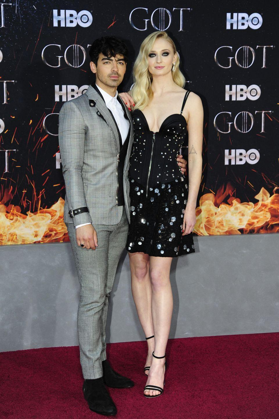 """<p>Jonas supports his then-girlfriend at the premiere for the final season of <a href=""""https://www.elle.com/uk/life-and-culture/a27623848/sophie-turner-abortion-alabama-game-of-thrones-northern-ireland/"""" rel=""""nofollow noopener"""" target=""""_blank"""" data-ylk=""""slk:her long-running how Game Of Thrones."""" class=""""link rapid-noclick-resp"""">her long-running how Game Of Thrones. </a></p>"""