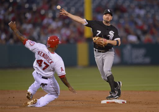 Chicago White Sox second baseman Jeff Keppinger (7) makes the throw to first base as Los Angeles Angels second baseman Howie Kendrick (47) slides into the bag on a double play attempt in the second inning of a baseball game, Friday, May 17, 2013 in Anaheim, Calif. Kendrick was out at second and Los Angeles Angels third baseman Alberto Callaspo (6) was out at first. (AP Photo/Mark J. Terrill)