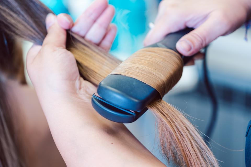 "Jennifer Arce and her colleagues discovered that the Brazilian blowout would ""reactivate"" in clients who had the treatment done elsewhere when their hair was exposed to heat from a blow dryer or flat iron. (Photo: Getty Creative)"