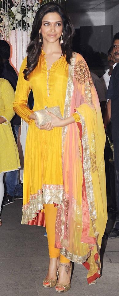 Deepika looks stunning in this yellow asymmetrical anarkali. It's a great look for a mehendi function as the colours work best for it.