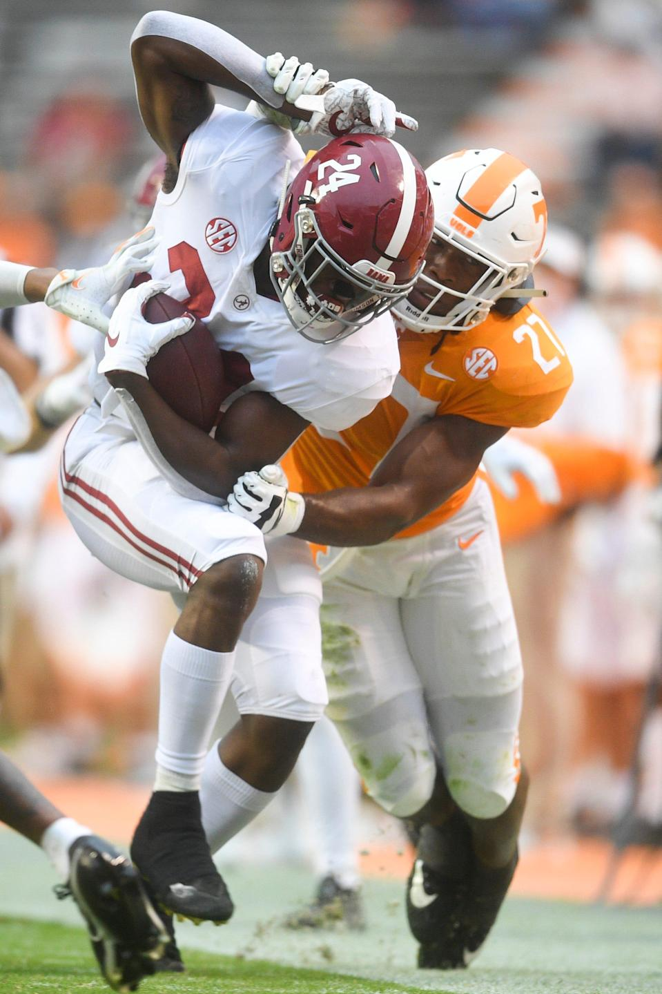 Alabama running back Trey Sanders (24) is tackled by Tennessee linebacker Quavaris Crouch (27) in the third quarter in the second half during a game between Alabama and Tennessee at Neyland Stadium in Knoxville, Tenn. on Saturday, Oct. 24, 2020.