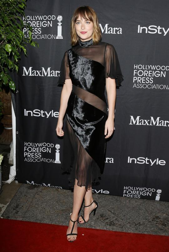 "<p>Dakota Johnson knows how to make an entrance! Pictured arriving at the ""Trumbo"" premiere during the 2015 Toronto International Film Festival, the actress wore a black Christopher Kane dress with velvet diagonal velvet panels overlaying a totally sheer material.</p>"
