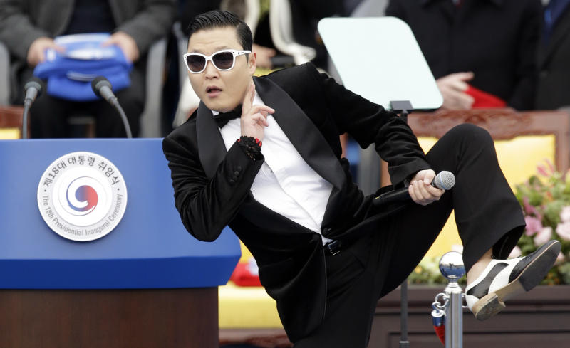 "FILE - In this Feb. 25, 2013 file photo, South Korean rapper PSY performs before President Park Geun-hye's presidential inauguration ceremony at the National Assembly in Seoul, South Korea.  PSY said Monday, March 18, 2013, on a Twitter-like South Korean website that he will change the title of his potential ""Gangnam Style"" follow-up over worries it could offend Arabs. PSY said earlier this week that his new song could carry a title that can be written as ""Assarabia"" or ""Assaravia"" in English. The expression is slang used by young South Koreans to express thrills. It suggests no ethnicity or body part. (AP Photo/Lee Jin-man, File)"