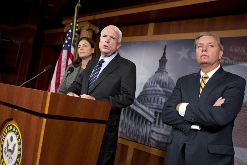 Sen. John McCain, R-Ariz., ranking Republican on the Senate Armed Services Committee, center, accompanied by fellow committee members, Sen. Kelly Ayotte, R-N.H., left, and Sen. Lindsey Graham, R-S.C., speaks during a news conference on Capitol Hill in Washington, Wednesday, Nov. 14, 2012, where he said he would do all he could to block the nomination of United Nations Ambassador Susan Rice to replace Secretary of State Hillary Rodham Clinton because of comments she made after the deadly Sept. 11 attack on the U.S. consulate in Benghazi. (AP Photo/J. Scott Applewhite)