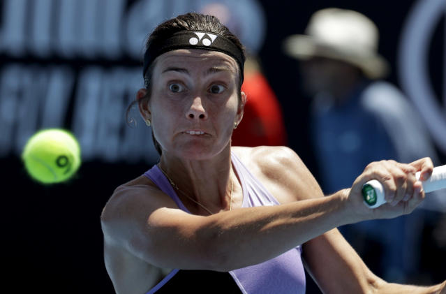 Latvia's Anastasija Sevastova makes a backhand return to China's Wang Qiang during their third round match at the Australian Open tennis championships in Melbourne, Australia, Saturday, Jan. 19, 2019. (AP Photo/Aaron Favila)