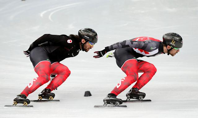 FILE PHOTO: Charles Hamelin (L) and his brother Francois of Canada skate together in preparation for the 2014 Sochi Winter Olympics at the Iceberg Skating Palace February 4, 2014. REUTERS/Lucy Nicholson/File Photo