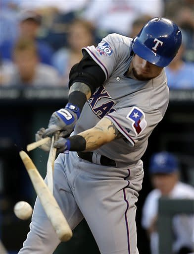 Texas Rangers' Josh Hamilton breaks his bat as he flies out during the first inning of a baseball game against the Kansas City Royals, Thursday, Sept. 6, 2012, in Kansas City, Mo. (AP Photo/Charlie Riedel)