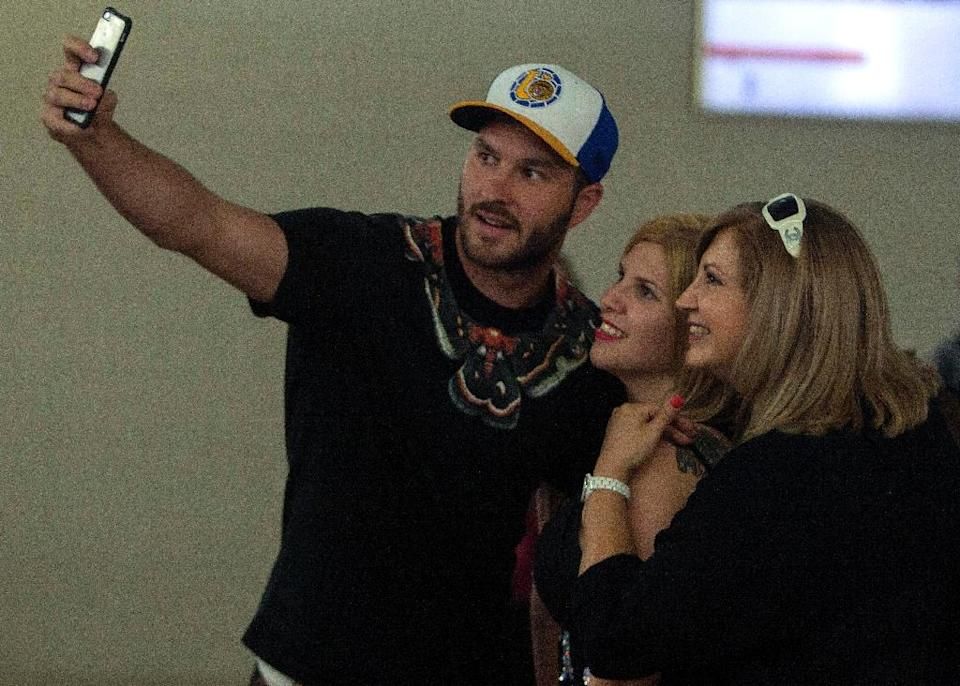 French striker Andre Pierre Gignac poses for a selfie with fans upon arrival at the airport of Monterrey, Mexico on June 18, 2015 (AFP Photo/Julio Cesar Aguilar)