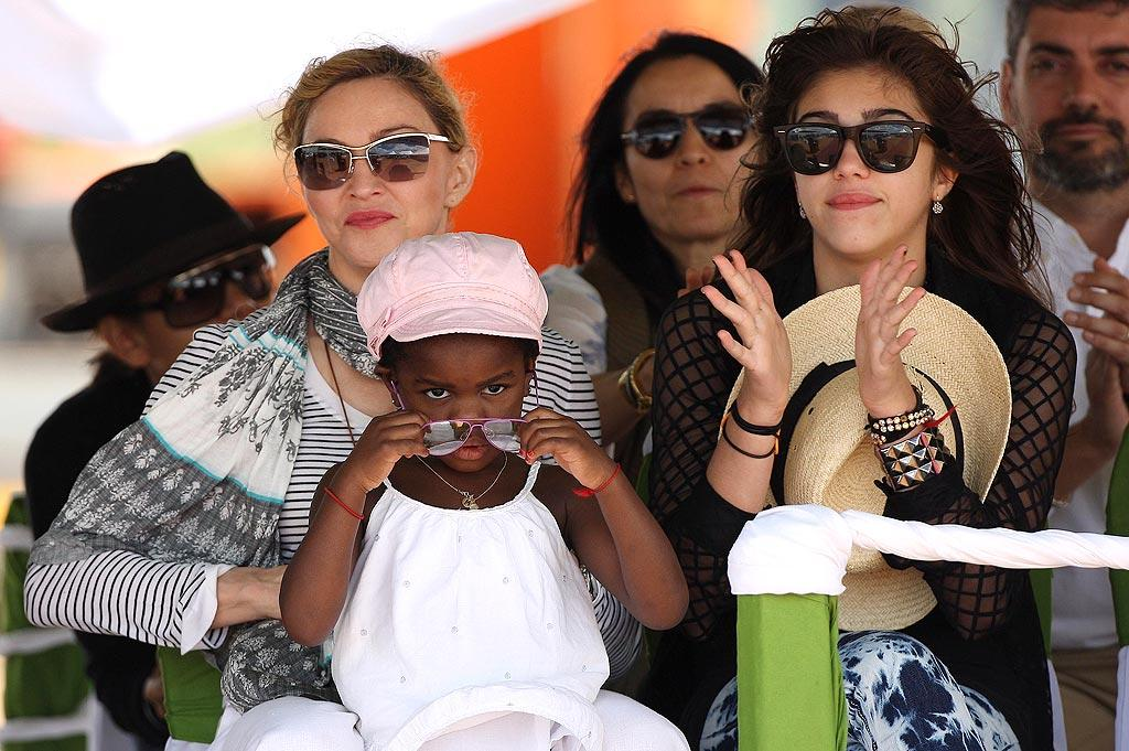"""Also giving back was another Hollywood icon. Madonna and her two daughters, Mercy, 4, and Lourdes, 13, attended a special ceremony in Malawi where the Queen of Pop laid the first brick at her Raising Malawi Academy for Girls, which is set to open in 2011. KCSPresse/<a href=""""http://www.splashnewsonline.com/"""" target=""""new"""">Splash News</a> - April 6, 2010"""