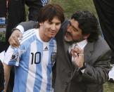 Diego Maradona (right) hugs Lionel Messi during his stint as Argentina national football coach at the 2010 World Cup. (PHOTO: Reuters/Amr Abdallah Dalsh)