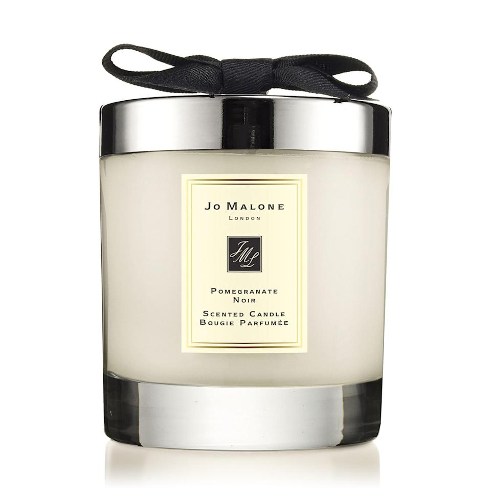 """The official fruit mascot of fall is pomegranate, so while Jo Malone's Pomegranate Noir candle is on the zestier side, it still fits nicely into the season without being too on-the-nose. Jo Malone is known for its complex fragrances, and this candle's plum notes have whispers of spice that layer perfectly. $67, Nordstrom. <a href=""""https://www.nordstrom.com/s/jo-malone-london-pomegranate-noir-scented-home-candle/3010778"""" rel=""""nofollow noopener"""" target=""""_blank"""" data-ylk=""""slk:Get it now!"""" class=""""link rapid-noclick-resp"""">Get it now!</a>"""