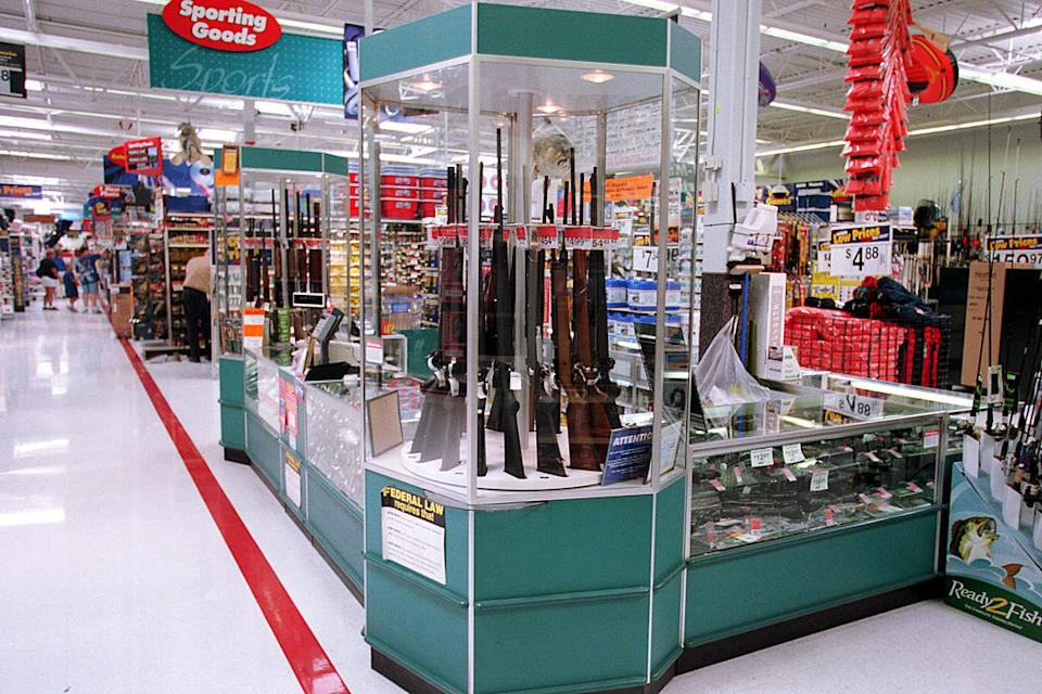 Guns for sale in a cabinet at a Walmart store in the US.