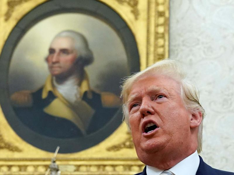 George Washington's portrait looks down on Donald Trump in the Oval Office: Kevin Lamarque/Reuters