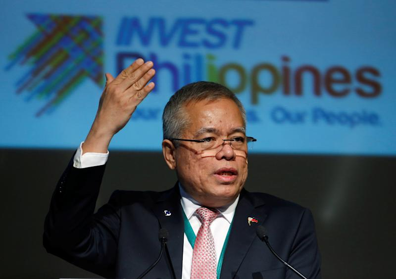 FILE PHOTO: Philippine Trade Secretary Ramon Lopez gives a speech at Philippine Economic Forum in Tokyo, Japan October 26, 2016. REUTERS/Kim Kyung-Hoon