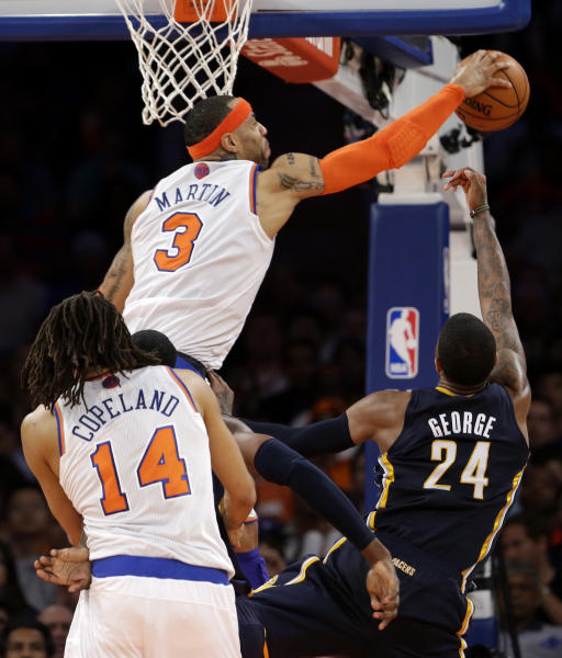New York Knicks' Kenyon Martin (3) blocks a shot by Indiana Pacers' Paul George (24) in the second half of Game 5 of an Eastern Conference semifinal in the NBA basketball playoffs, at Madison Square Garden in New York, Thursday, May 16, 2013. (AP Photo/Julio Cortez)