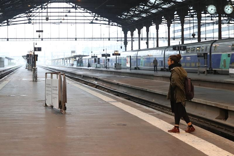 A passenger waits at the Gare de Lyon railway station in Paris on June 1 at the start of a strike by employees of French state-owned rail operator against government labour reforms (AFP Photo/Kenzo Tribouillard)